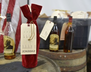 Evidence tags mark recovered bottles of Pappy Van Winkle bourbon shown during a news conference at the Franklin County Sheriff's Office, Tuesday, April 21, 2015, in Frankfort, Ky. Nine people were indicted relating to the theft of more than $100,000 worth of bourbon from the Wild Turkey and Buffalo Trace distilleries. (AP Photo/Timothy D. Easley)
